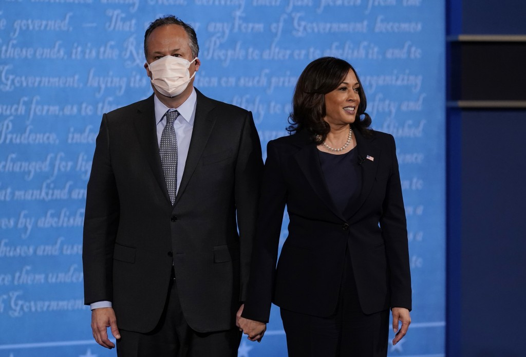 Democratic vice presidential candidate Sen. Kamala Harris, D-Calif., stands with her husband Douglas Emhoff during the vice presidential debate with V...
