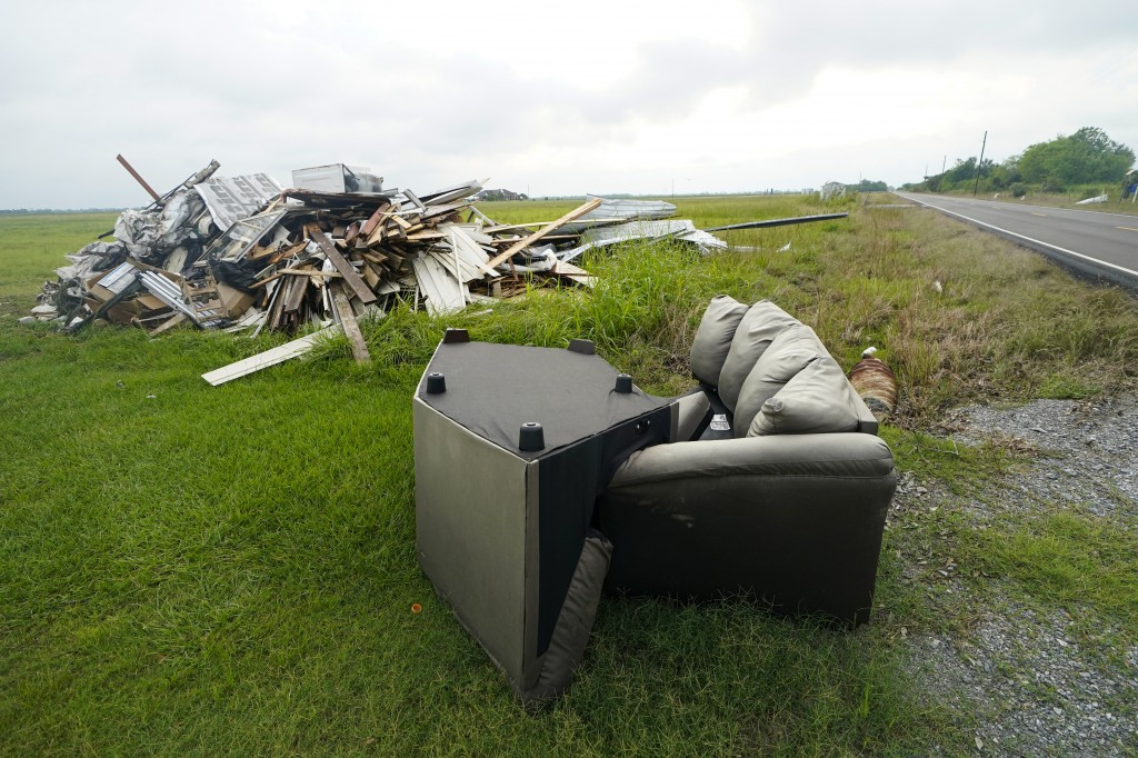 Debris from Hurricane Laura is pilled up in Bell City, La., Thursday, Oct. 8, 2020, as Hurricane Delta approached the Gulf Coast. Louisiana residents ...