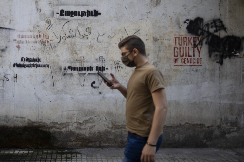 Anti-Turkish graffiti adorns a wall in the main Armenian district of the northern Beirut suburb of Bourj Hammoud, Lebanon, Tuesday, Oct. 6, 2020. In B...