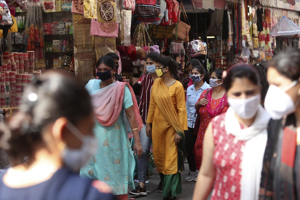 Indians wearing face masks as a precaution against the coronavirus walk in a market in Jammu, India, Friday, Oct. 9, 2020. India is the world's second...