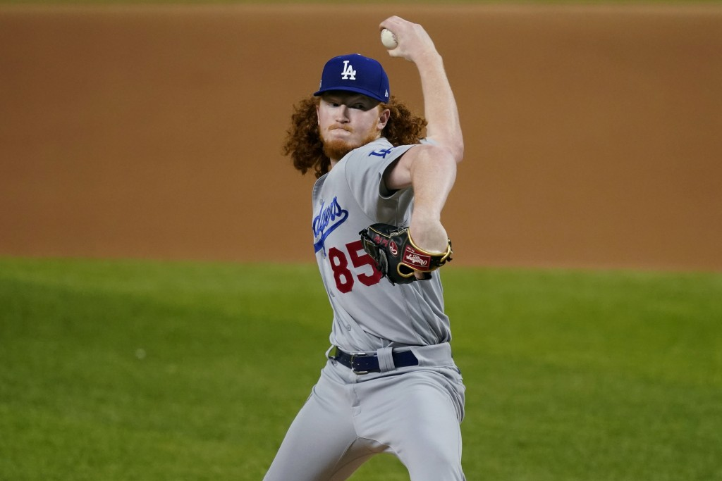 Los Angeles Dodgers starting pitcher Dustin May delivers to the San Diego Padres during the first inning in Game 3 of a baseball National League Divis...