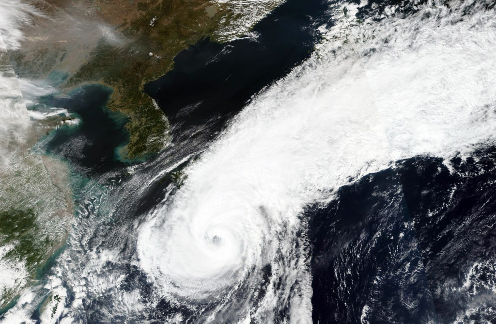 This Thursday, Oct. 8, 2020, satellite image released by NASA Worldview, Earth Observing System Data and Information System (EOSDIS) shows the clouds ...