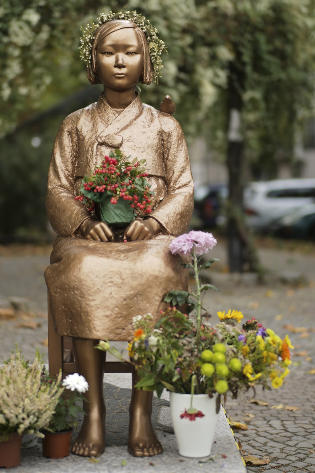 """A statue of a """"comfort woman,"""" a euphemism for womenenslaved for sex by the Japanese army during World War II, in Berlin."""