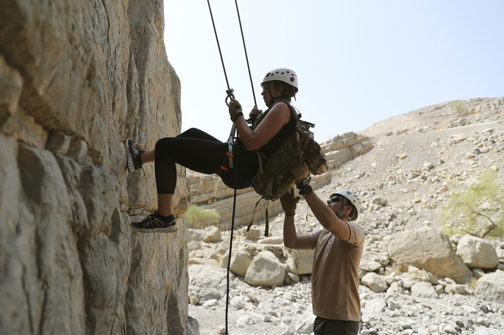 One of the guests rappel down a rock mountain during a survival trial at the Jebel Jais, about 30 kms north east of Ras al-Khaimah, United Arab Emirat...