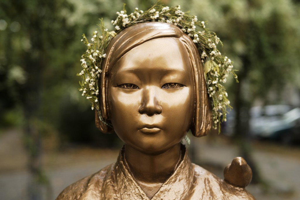 A statue commemorating so-called 'comfort women', an euphemism given by Japan to the women and girls enslaved for sex by the Japanese army during Worl...
