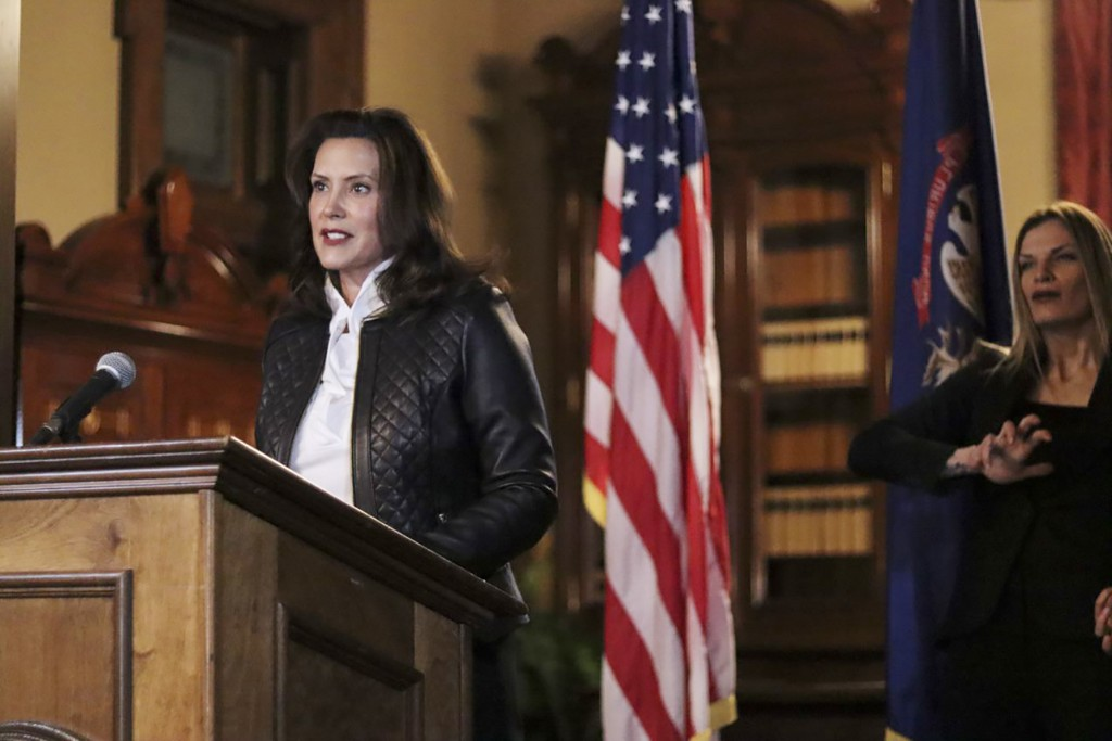 In a photo provided by the Michigan Office of the Governor, Michigan Gov. Gretchen Whitmer addresses the state during a speech in Lansing, Mich., Thur...