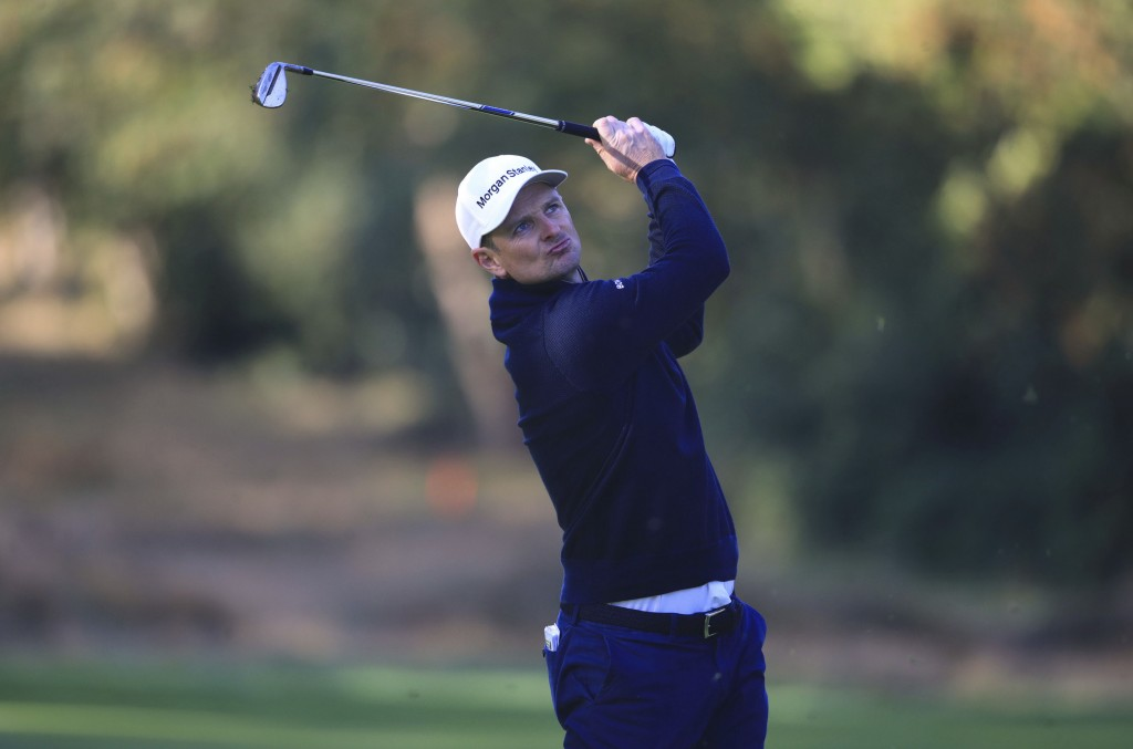 England's Justin Rose plays from the 16th fairway on day two of the PGA Championship at Wentworth Club, Virginia Water, England, Friday Oct. 9, 2020. ...