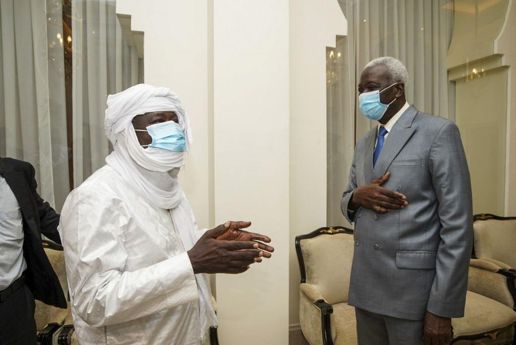 In this photo provided by the Mali Presidency, three-time Malian presidential candidate and ex-hostage Soumaila Cisse, left, meets with transitional p...