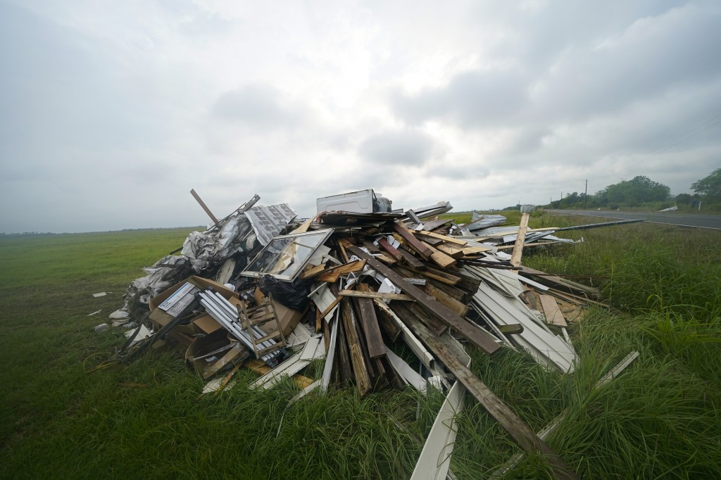 Debris from Hurricane Laura is pilled up in Bell City, La. Thursday, Oct. 8, 2020, as Hurricane Delta approached the Gulf Coast. Louisiana residents s...