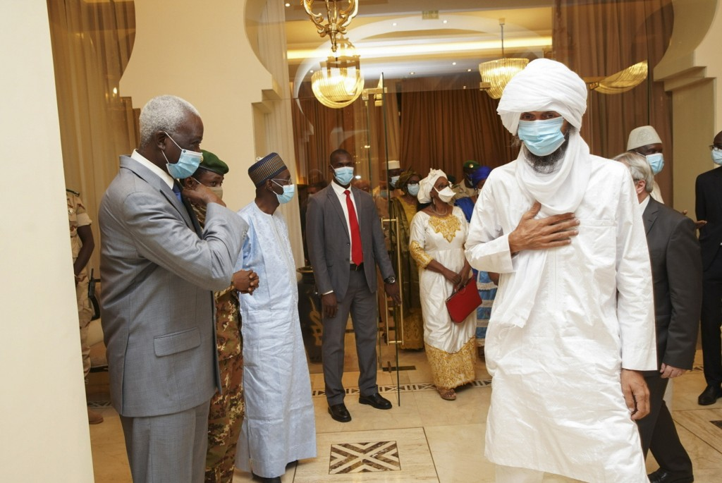 In this photo provided by the Mali Presidency, Italian ex-hostage Nicola Chiacchio, right, meets with transitional president Col. Maj. Bah N'Daw, left...