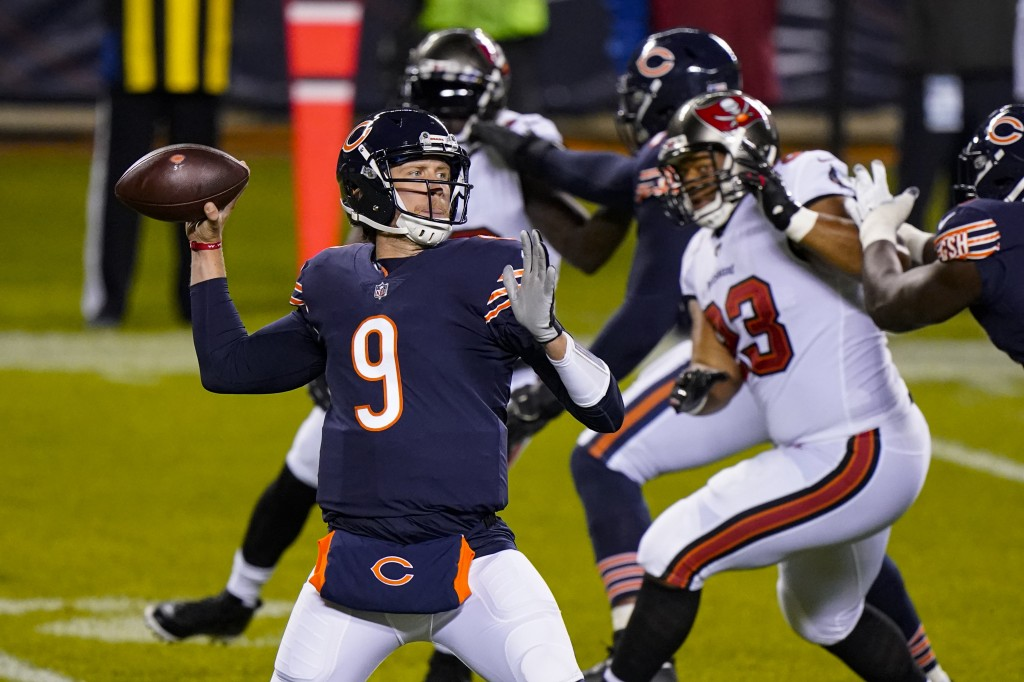 Chicago Bears quarterback Nick Foles (9) throws a pass during the first half of the team's NFL football game against the Tampa Bay Buccaneers in Chica...