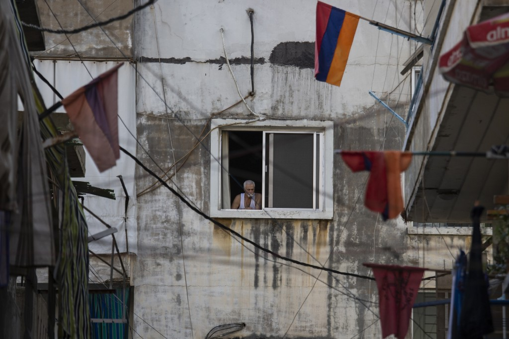 Armenian national flags hang from apartment balconies in the main Armenian district of the northern Beirut suburb of Bourj Hammoud, Lebanon, Tuesday, ...