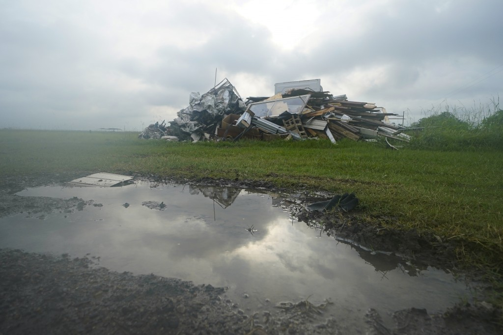 Debris from Hurricane Laura is piled up in Bell City, La., Thursday, Oct. 8, 2020, as Hurricane Delta approached the Gulf Coast. Louisiana residents s...