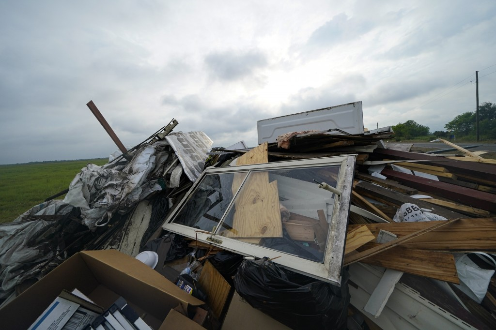 CORRECTS DATE TO OCT. 8, 2020 - Debris from Hurricane Laura is piled up in Bell City, La. Thursday, Oct. 8, 2020, as Hurricane Delta approached the Gu...