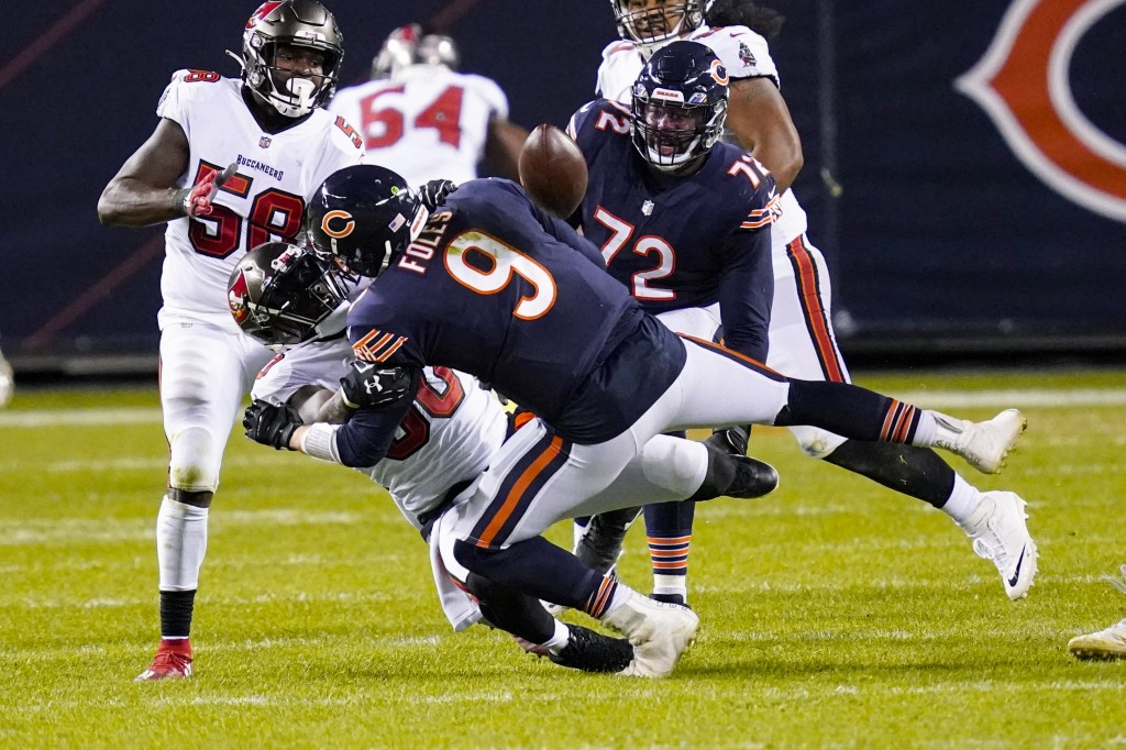 Chicago Bears quarterback Nick Foles (9) fumbles the ball as he's sacked by Tampa Bay Buccaneers outside linebacker Jason Pierre-Paul (90) during the ...