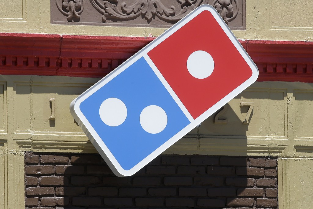 FILE - In this July 15, 2019 file photo shows a Domino's location in Norwood, Mass. Domino's Pizza saw stronger U.S. same-store sales in the July-Sept...