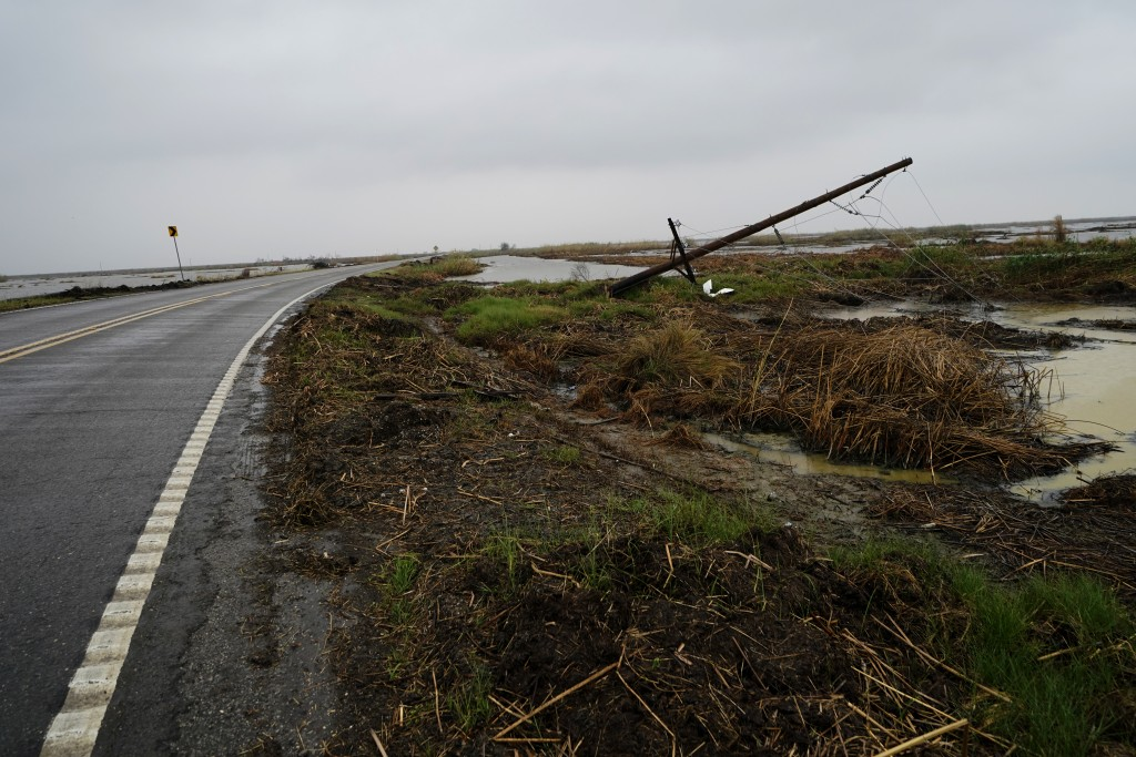 Downed power lines from Hurricane Laura line a desolate stretch of marsh on Hwy 27, leading to the town of Cameron, La., in advance of Hurricane Delta...