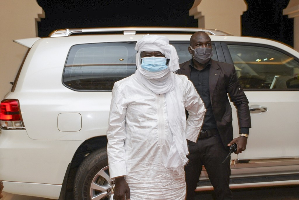 In this photo provided by the Mali Presidency, three-time Malian presidential candidate and ex-hostage Soumaila Cisse, center, arrives at the presiden...