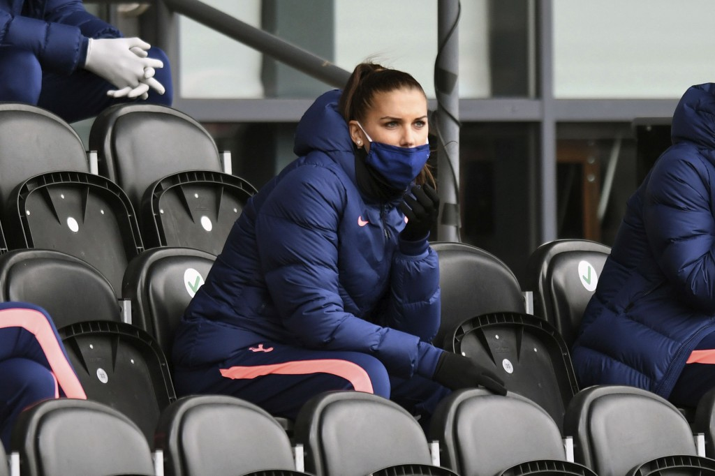 Tottenham Hotspur's Alex Morgan sit in the stands during the FA Women's Super League soccer match between Tottenham Hotspur and Manchester United, at ...