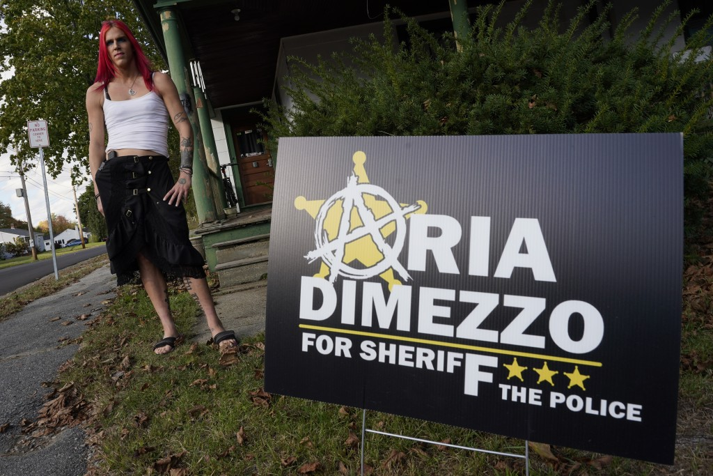 Aria DiMezzo, a Republican candidate for sheriff in Cheshire County, New Hampshire, poses outside her campaign headquarters and work place, Tuesday, O...
