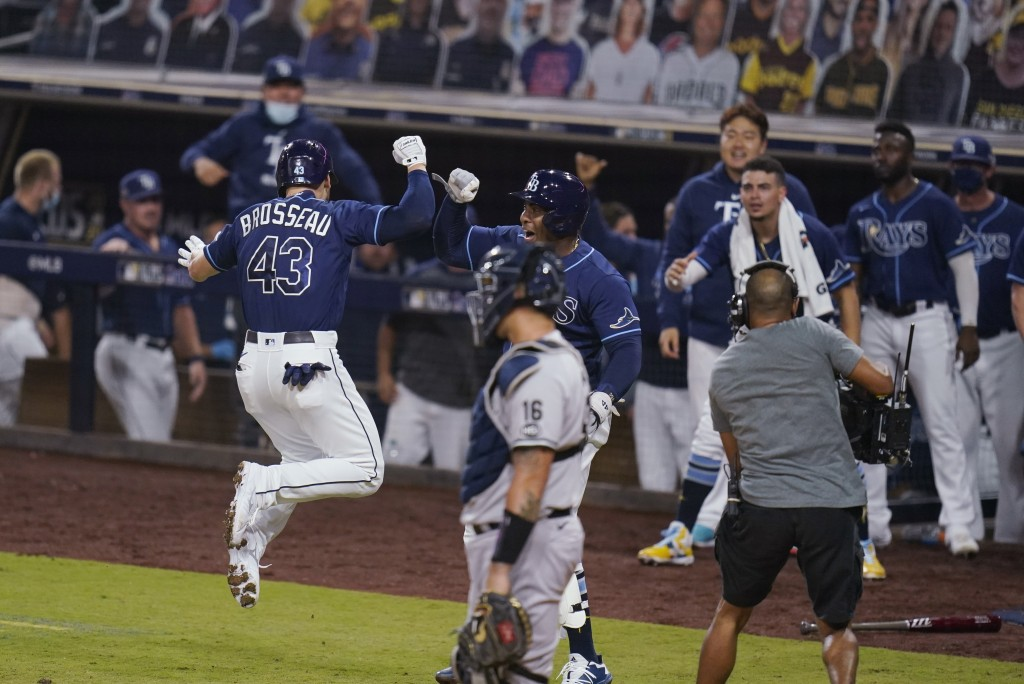 Tampa Bay Rays' Michael Brosseau (43) celebrates after hitting a solo home run during the eighth inning in Game 5 of the baseball team's AL Division S...