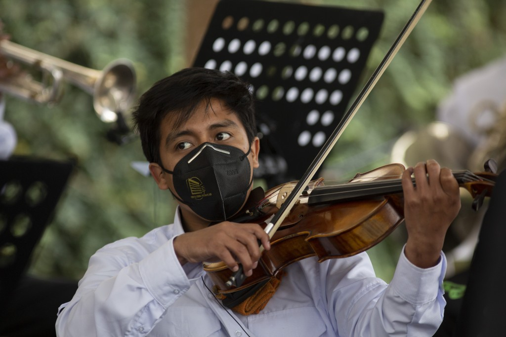 A musician plays during a tribute by health workers at the San Juan de Dios hospital in memory of their colleagues who died from COVID-19, at the hosp...