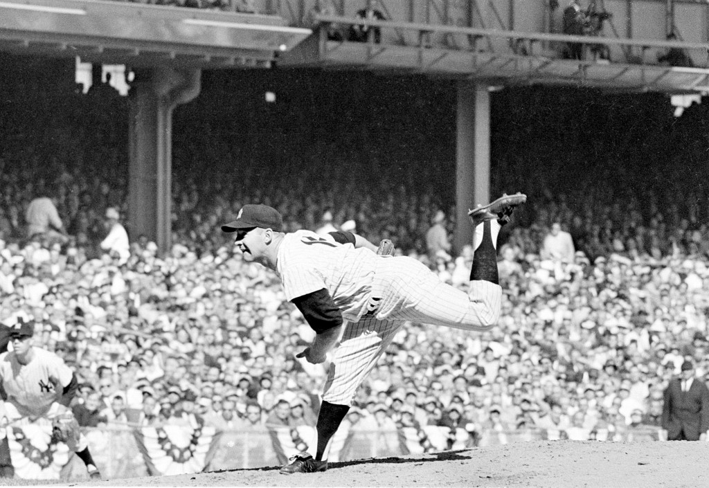 FILE - In this Oct. 8, 1960 file photo, New York Yankees pitcher Whitey Ford throws against the Pittsburgh Pirates in the third World Series game at Y...