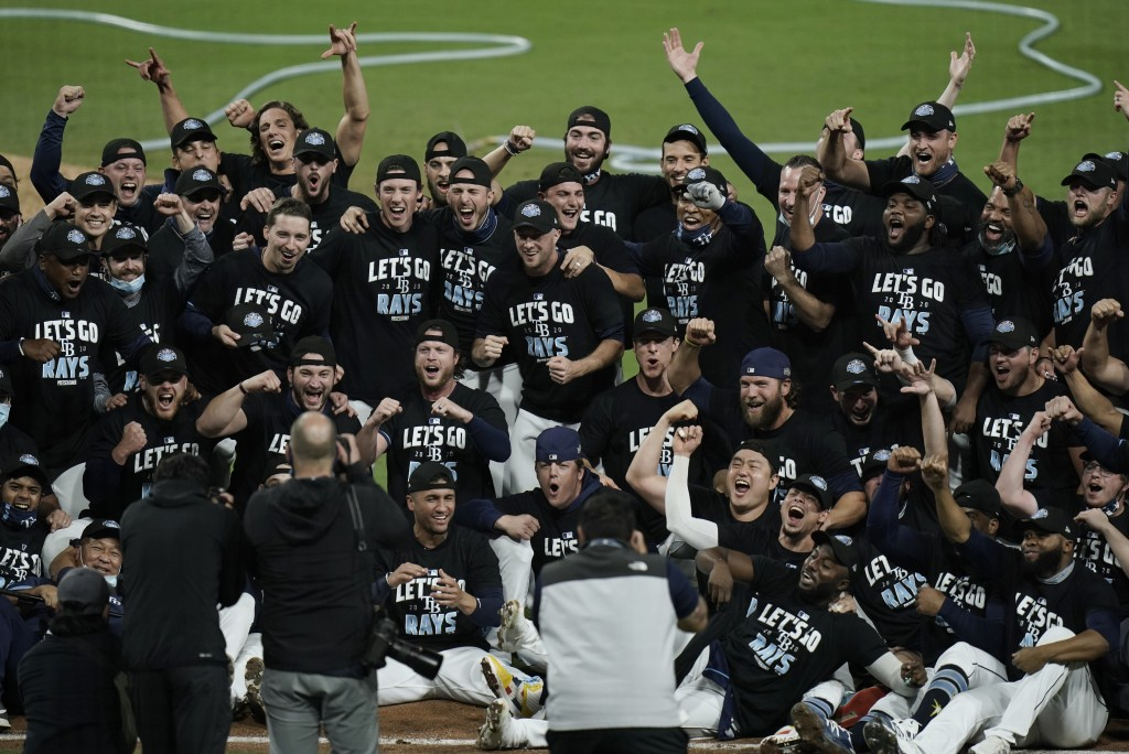 The Tampa Bay Rays celebrate after defeating the New York Yankees 2-1 in Game 5 of a baseball AL Division Series, Friday, Oct. 9, 2020, in San Diego. ...