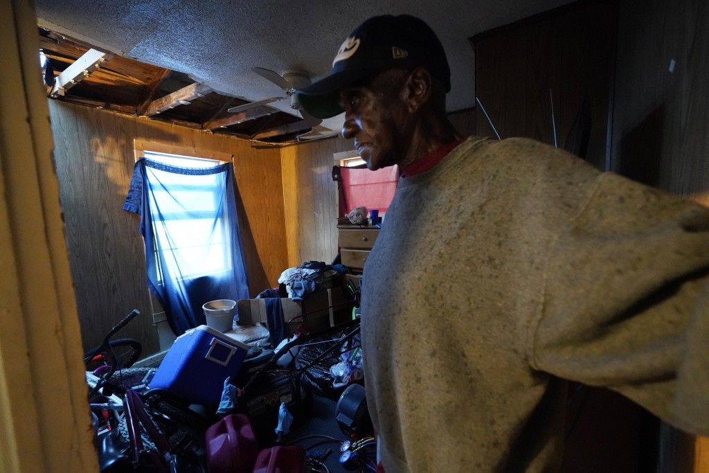 Ernest Jack moves through his home that was hit by Hurricane Laura ahead of Hurricane Delta, Friday, Oct. 9, 2020, in Lake Charles, La. Forecasters sa...