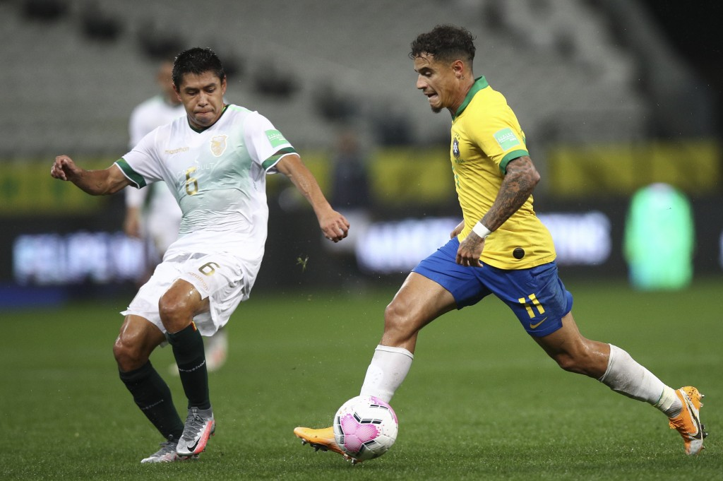 Brazil's Philippe Coutinho, right, runs with the ball as Bolivia's Diego Wayar challenges him during a qualifying soccer match for the FIFA World Cup ...