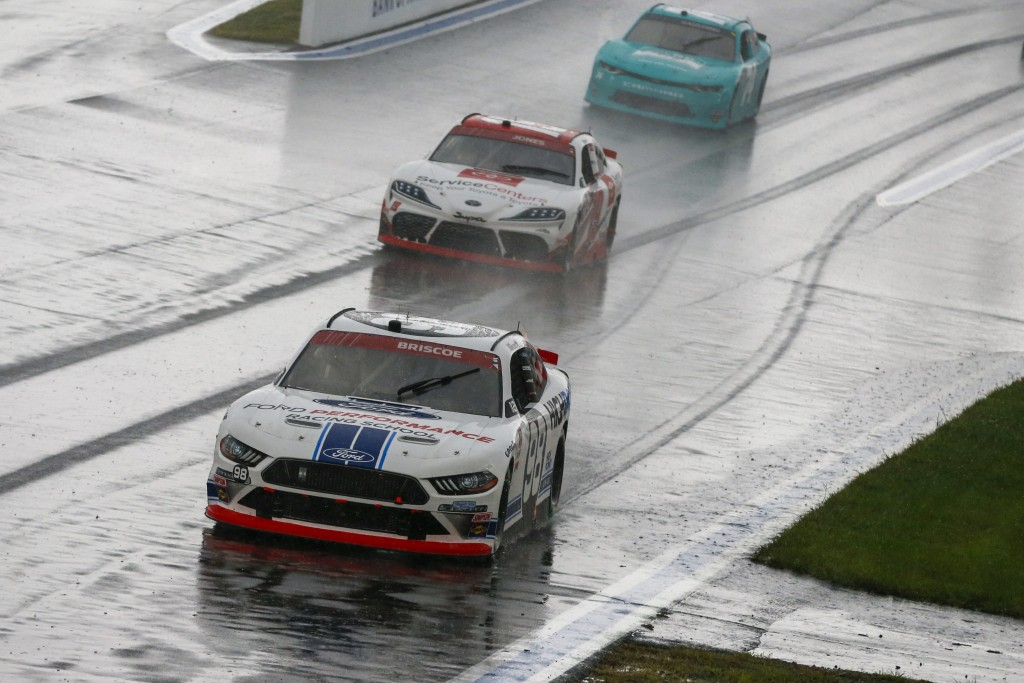 (L-R) Chase Briscoe, Brandon Jones and Gray Gauilding compete in the rain during a NASCAR Xfinity Series auto race at Charlotte Motor Speedway in Conc...
