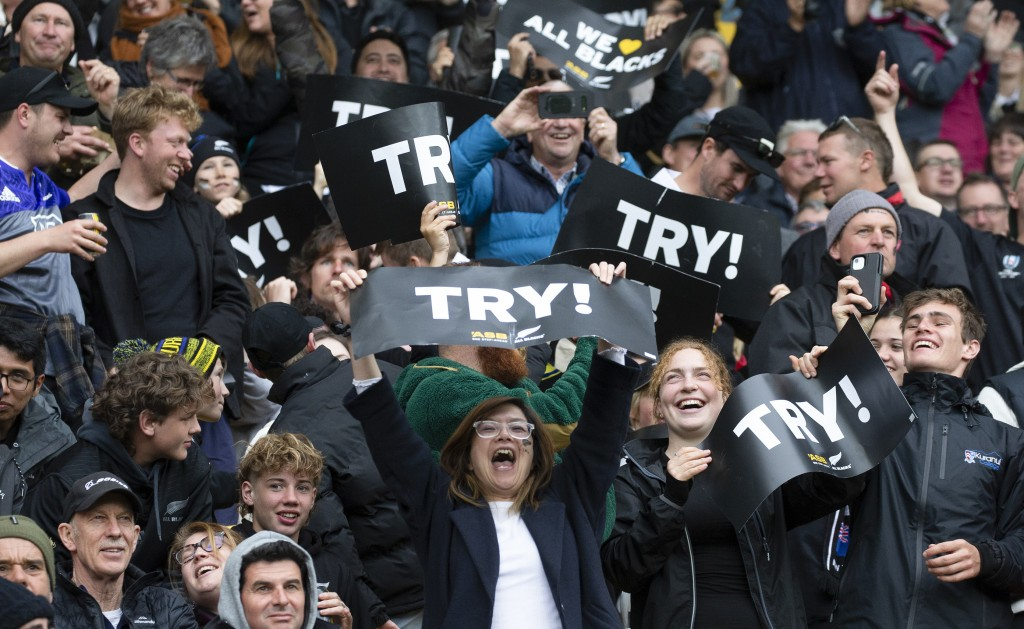 New Zealand fans celebrate during the Bledisloe Cup rugby game between the All Blacks and the Wallabies in Wellington, New Zealand, Sunday, Oct.11, 20...