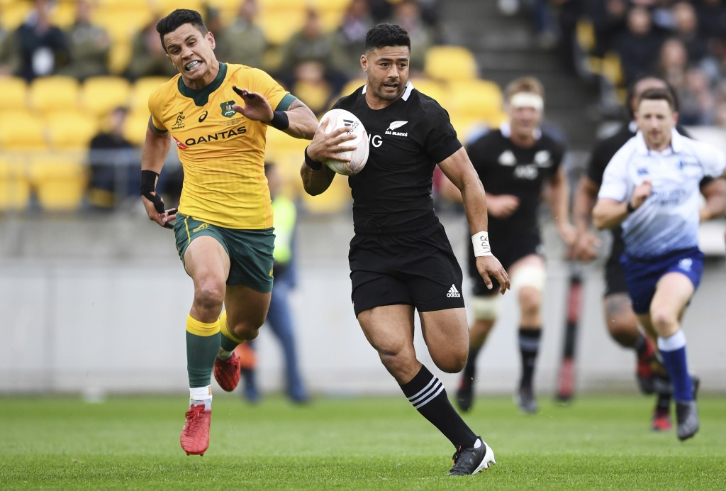 New Zealand's Richie Mo'unga is chased by Australia's Matt To'omua, left, during the Bledisloe Cup rugby game between the All Blacks and the Wallabies...