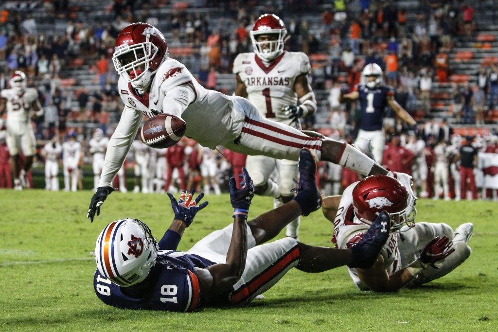 Arkansas defensive back Hudson Clark breaks up a pass intended for Auburn wide receiver Seth Williams (18) during the second half of an NCAA college f...