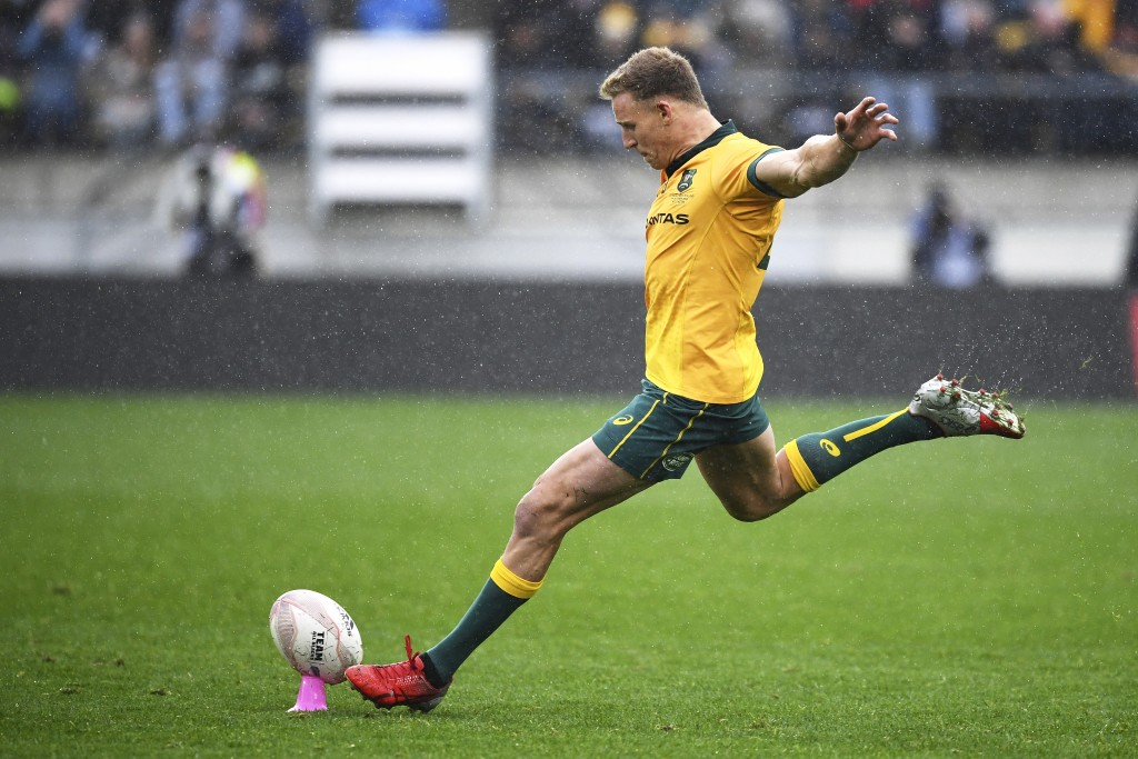 Australia's Reece Hodge takes a penalty shot at goal during the Bledisloe Cup rugby game between the All Blacks and the Wallabies in Wellington, New Z...