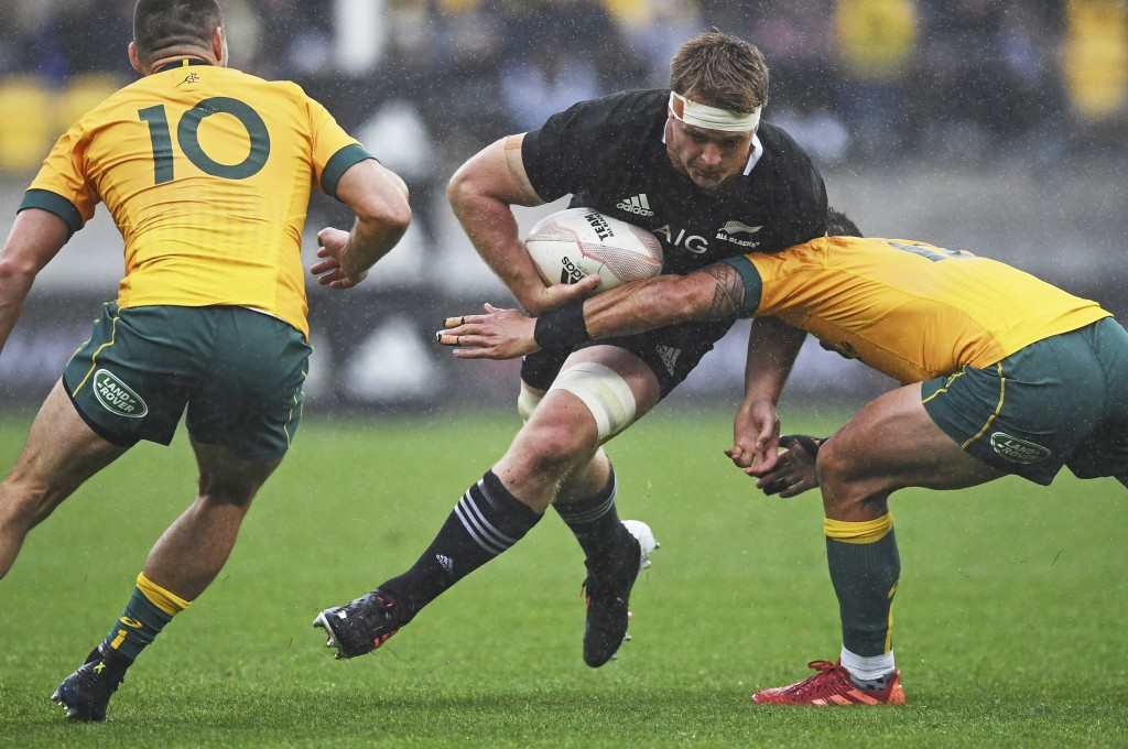 New Zealand's Sam Cane runs at the defence during the Bledisloe Cup rugby game between the All Blacks and the Wallabies in Wellington, New Zealand, Su...