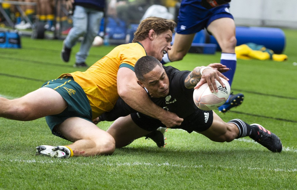 New Zealand's Aaron Smith scores a try in the tackle of Australia's Michael Hooper during the Bledisloe Cup rugby game between the All Blacks and the ...