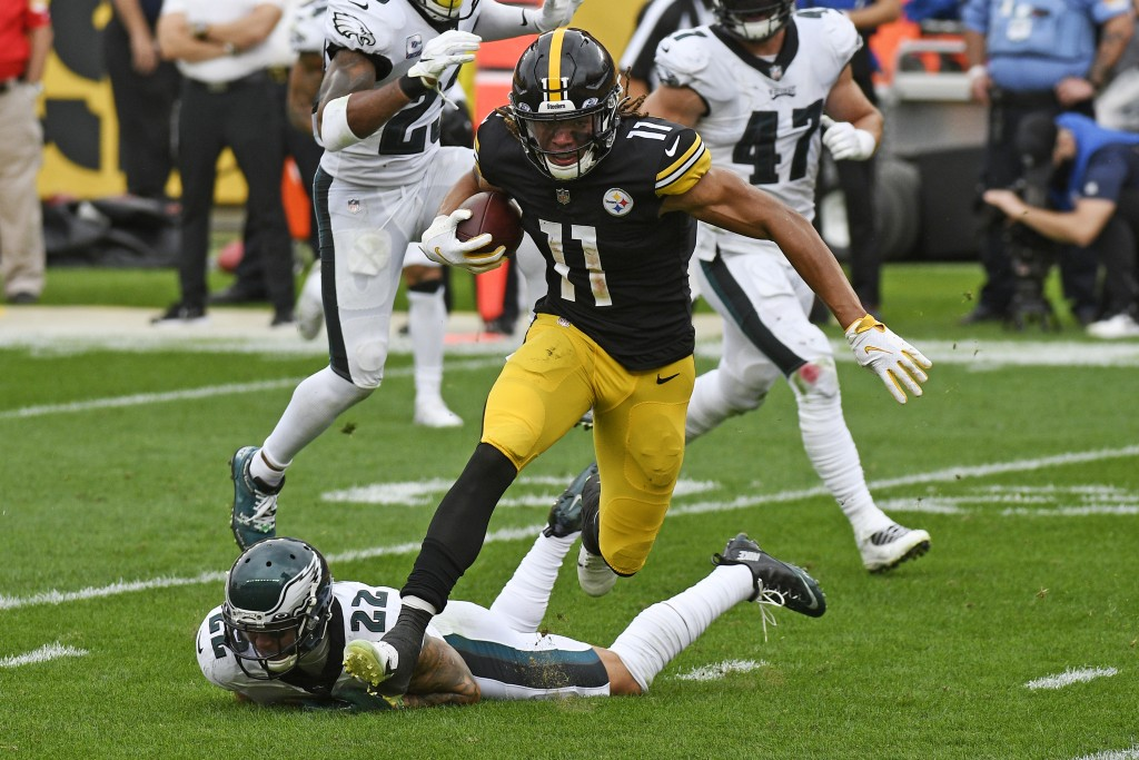 Pittsburgh Steelers wide receiver Chase Claypool (11) gets past Philadelphia Eagles safety Marcus Epps (22) after taking a pass from quarterback Ben R...