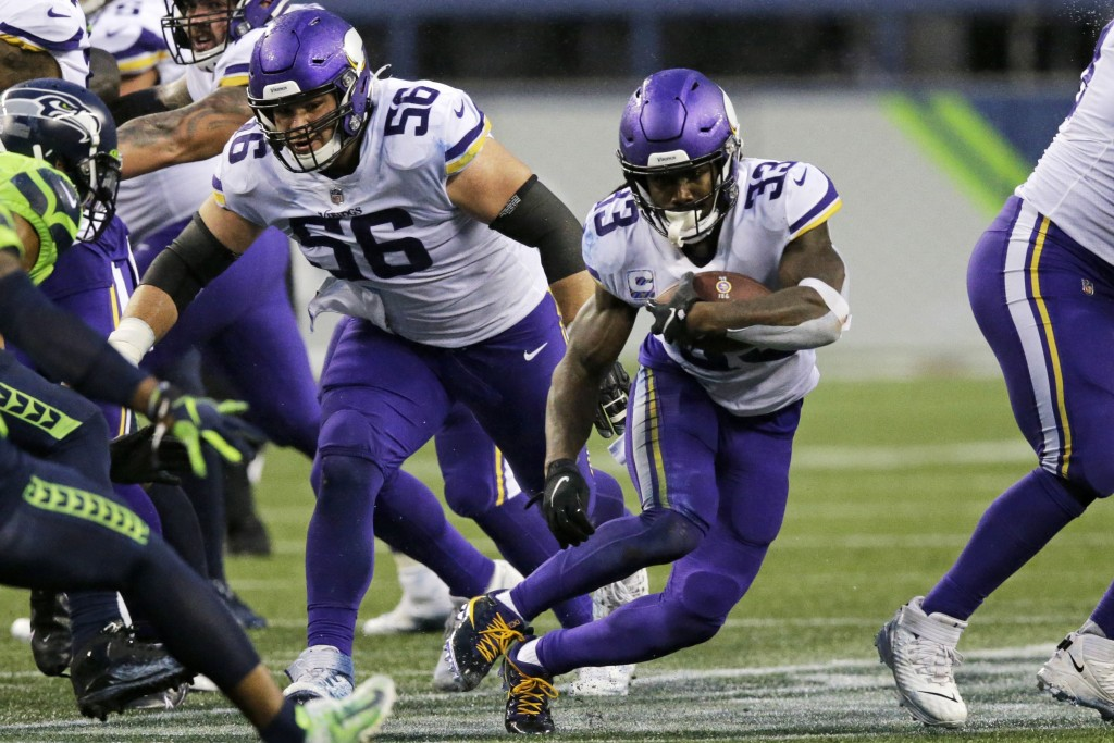 Minnesota Vikings' Dalvin Cook (33) rushes against the Seattle Seahawks during the first half of an NFL football game, Sunday, Oct. 11, 2020, in Seatt...