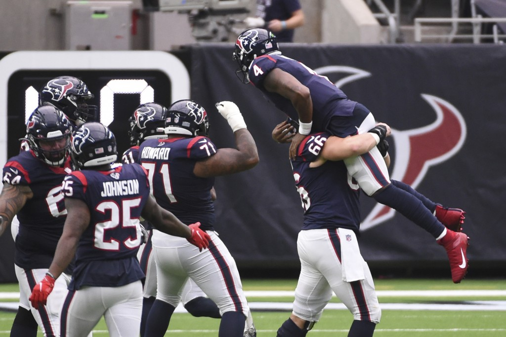 Houston Texans quarterback Deshaun Watson (4) is lifted in the air by teammate Nick Martin (66) as the team celebrates a touchdown against the Jackson...