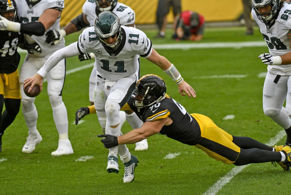 Philadelphia Eagles quarterback Carson Wentz (11) is sacked by Pittsburgh Steelers outside linebacker T.J. Watt (90) during the first half of an NFL f...