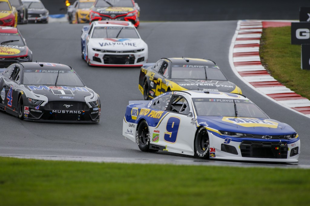 Chase Elliott leads the way out of turn 7 as he competes in a NASCAR Cup Series auto race at Charlotte Motor Speedway in Concord, N.C., Sunday, Oct. 1...