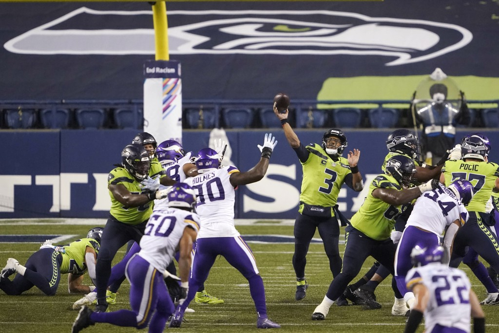Seattle Seahawks quarterback Russell Wilson passes against the Minnesota Vikings late in the second half of an NFL football game, Sunday, Oct. 11, 202...