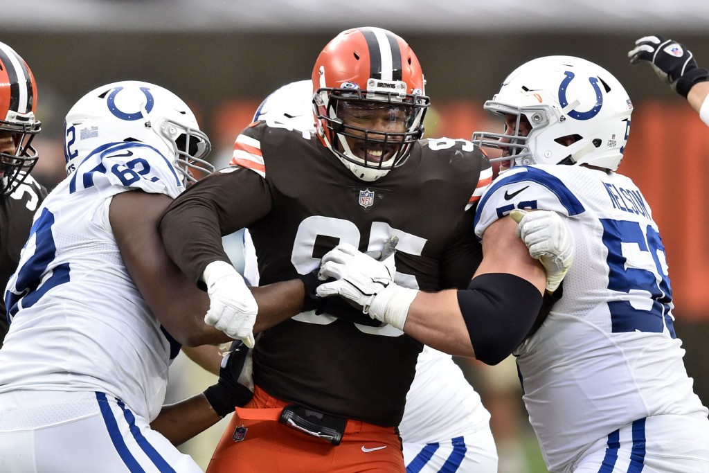 Cleveland Browns defensive end Myles Garrett (95) rushes the passer during the first half of an NFL football game against the Indianapolis Colts, Sund...