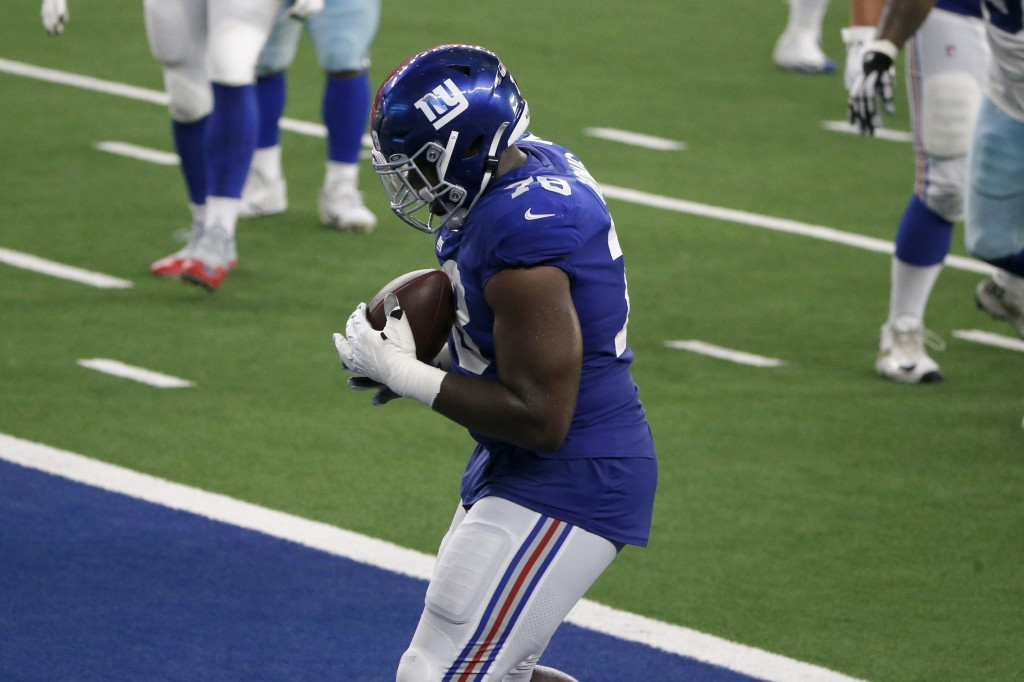 New York Giants offensive tackle Andrew Thomas (78) catches a pass for a two-point conversion in the second half of an NFL football game against the D...