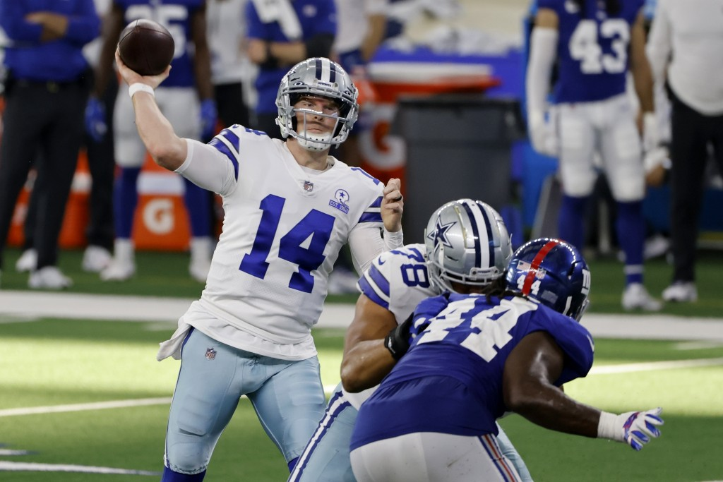 Dallas Cowboys quarterback Andy Dalton (14) throws a pass as New York Giants linebacker Markus Golden (44) pressures in the second half of an NFL foot...