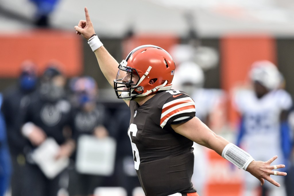 Cleveland Browns quarterback Baker Mayfield celebrates a 15-yard touchdown pass to wide receiver Rashard Higgins during the first half of an NFL footb...