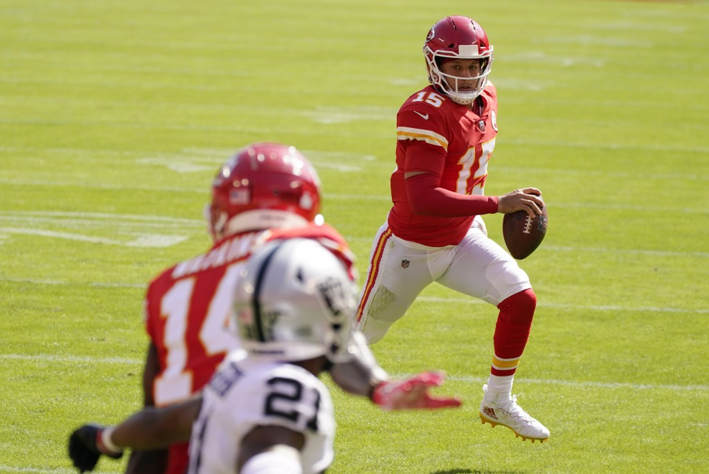 Kansas City Chiefs quarterback Patrick Mahomes (15) scores on a 3-yard touchdown run during the first half of an NFL football game against the Las Veg...