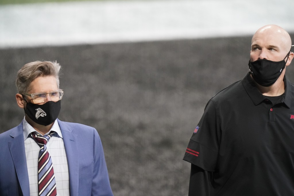 FILE - In this Sept. 27, 2020, file photo, Atlanta Falcons general manager Thomas Dimitroff, left, speaks with Falcons head coach Dan Quinn before an ...