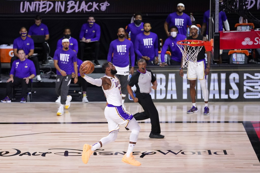 Los Angeles Lakers' LeBron James (23) goes up for a dunk during the first half in Game 6 of basketball's NBA Finals against the Miami Heat Sunday, Oct...